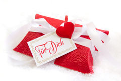 Close up of red present box with German text for christmas on wh Royalty Free Stock Image