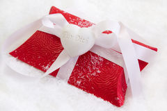 Close up of red present box with German text for christmas on wh Stock Photography