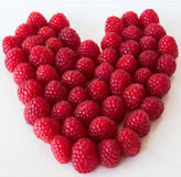 Close up of red raspberries in the shape of a heart Royalty Free Stock Photography
