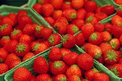 Close up red ripe strawberry on retail display. Close up fresh red ripe strawberry berries in paper container boxes on retail display of farmers market, high stock photos