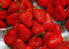Close up red ripe strawberry on retail display. Close up fresh red ripe strawberry berries in plastic container boxes on retail display of farmers market, high stock photos