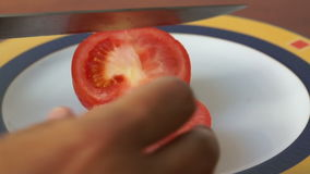 Close up. Red ripe tomato cut into two halves. On the plate stock footage
