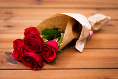 Close up of red roses bunch wrapped into paper Stock Photography