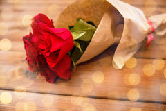 Close up of red roses bunch wrapped into paper Stock Photo