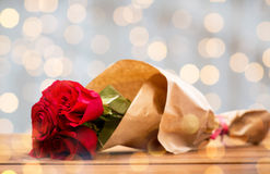 Close up of red roses bunch wrapped into paper Royalty Free Stock Image
