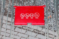 Close up of red shopping cart outside supermarket Stock Image