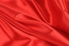 Close up of red silk fabric background. Royalty Free Stock Photos