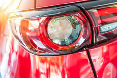 Close up of a red sport car in sunset. Background Royalty Free Stock Images