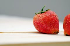 Close Up Red Strawberry. On the Table Wood Royalty Free Stock Photos