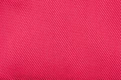 Textured synthetical background. Close up of red textured synthetical background Royalty Free Stock Image