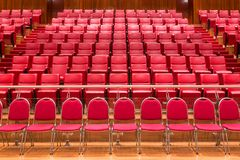 Close up red theatre chair in meeting room Royalty Free Stock Photos