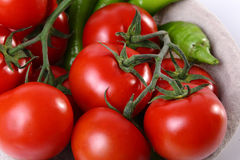 Close up of red tomatoes and green Stock Images