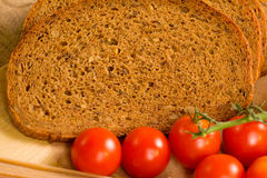 Close up of red tomatoes and slices of  rye bread Stock Photos