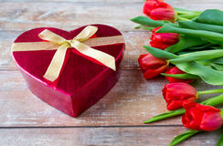 Close up of red tulips and chocolate box Stock Photo
