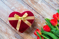 Close up of red tulips and chocolate box Stock Image