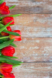 Close up of red tulips on wooden background Royalty Free Stock Images
