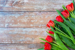 Close up of red tulips on wooden background Stock Photo