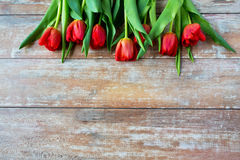 Close up of red tulips on wooden background Royalty Free Stock Photography
