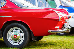 Close-up of red Volvo P1800. MINSK, BELARUS - MAY 07, 2016: Close-up photo of red Volvo P1800. Close-up of the rear of vintage car. Selective focus royalty free stock photos