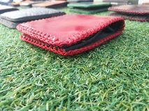 Red wallet on grass Royalty Free Stock Images