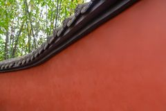 Aves of traditional. A close-up of the red walls and eaves of traditional Chinese culture royalty free stock photography