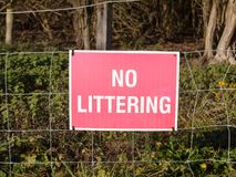 Close up of red and white country sign no littering. Essex; england; uk Royalty Free Stock Images