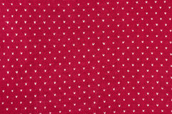 Close up on red and white dots woolen texture. Royalty Free Stock Image