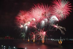 Close-up of a red and white fireworks display. Close-up of red and white fireworks exploding symbolizing New Year, celebration and pyrotechnics Stock Photography