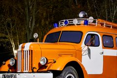 Close UP Red and White Soviet truck ZiL-164 Fire engine on a pedestal in Victory Park at night royalty free stock image