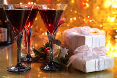 Close-up of red wine in glasses,candle and gifts Royalty Free Stock Photo