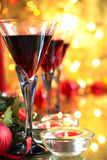 Close-up of red wine in glasses and candle lights. Stock Photo