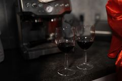 Close up of red wine glasses with lipstick mark stock photography