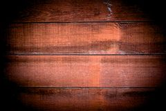 Close-up of Red wood panels used as background, red wood surface. vintage tone with vignetting stock image