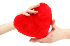 Close-up of red wooden heart in female hands. Showing it (isolated Royalty Free Stock Photos