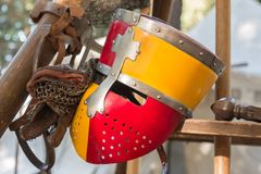 Close up of Medieval Knight`s Silver Helmet in Red and Yellow. Close up of Red and Yellow Medieval Knight`s Silver Helmet: Historical Event Reconstruction Royalty Free Stock Photography