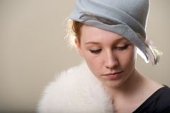 Close-up of redhead in fur looking down Stock Photography
