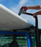 Close up refueling small airplane Stock Image