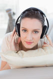 Close up of a relaxed casual woman enjoying music on sofa Royalty Free Stock Images