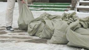 Unknown men taking bag with debris stock video