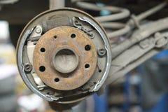 Close-up repair drum brake of car wheel in garage. Stock Photo