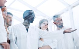 Chemists working in protective suits in the lab stock photo