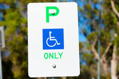 Close up reserved Parking sign disabled person Royalty Free Stock Images