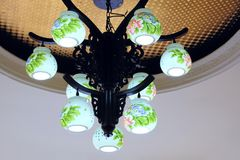 Restaurant chandelier. The close-up of restaurant ceiling and top chandelier Stock Images