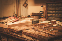 Close-up of the restorer worktable in his workshop Royalty Free Stock Images