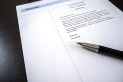 Close-up of resume and pen on table. Stock Image