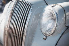 Close up retro do farol do carro foto de stock royalty free