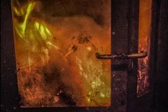 A burning furnace. A close-up of a retro furnace with a burning fire Royalty Free Stock Photography