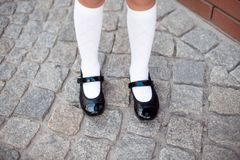 Close-up retro style image of school girl`s feet in uniform royalty free stock photography