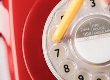 Close Up of Retro Telephone Dial with Pencil Royalty Free Stock Image