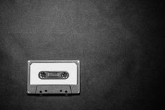 Close up of retro vintage audio cassette tape on black background stock image